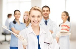 picture of attractive female doctor with toothbrush